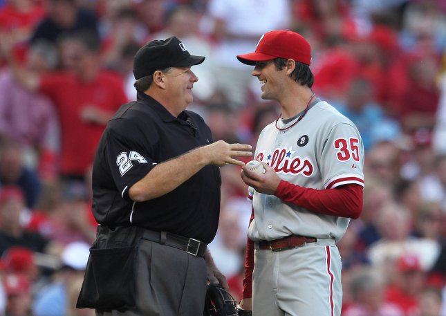 Home plate umpire Jerry Layne and Philadelphia Phillies pitcher Cole Hamels share a laugh during the third inning against the St. Louis Cardinals after Layne walked to the mound to give Hamels a new baseball in Game 3 of the NLDS at Busch Stadium in St. Louis on October 4, 2011. Layne was given the crew chief job for the 2011 World Series, baseball officials said Tuesday. UPI/Bill Greenblatt
