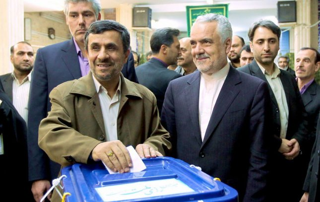 A handout picture released by the Iranian President Mahmoud Ahmadinejad's official website shows Ahmadinejad voting in the parliamentary elections at a polling station in Tehran, Iran on March 2, 2012. Iranians started voting for the ninth parliamentary elections since the Islamic Revolution in 1979. UPI