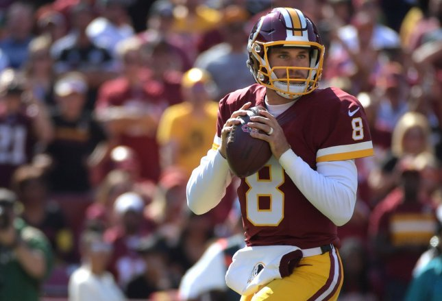 Washington Redskins quarterback Kirk Cousins (8) has a huge contract deal despite lackluster performance. Other teams might have dropped him like a hot, deflated football. Kevin Dietsch/UPI