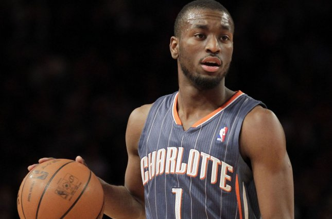 Charlotte Hornets guard Kemba Walker brings the ball up the court. File photo by John Angelillo/UPI