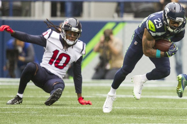 Seattle Seahawks free safety Earl Thomas (29) intercepts a pass intended for Houston Texans wide receiver DeAndre Hopkins (10) and returns it for a 78-yard touchdown in the first quarter on October 29 at CenturyLink Field in Seattle. Photo by Jim Bryant/UPI