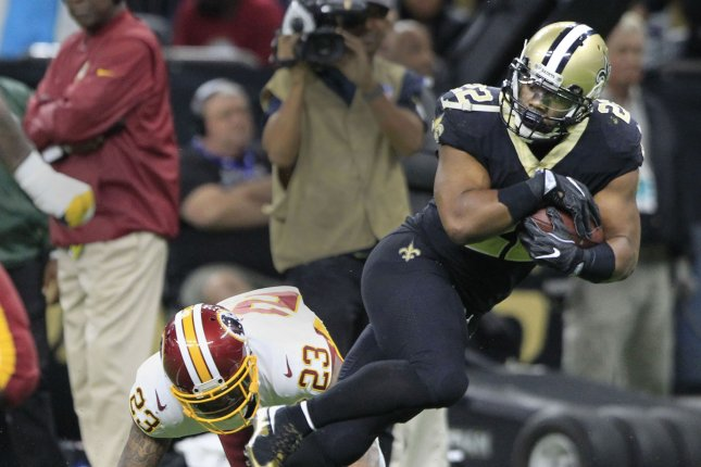 9a0acae79a0 New Orleans Saints running back Mark Ingram (22) runs past former Washington  Redskins defensive back DeAngelo Hall (23) for a 31-yard gain during  overtime ...