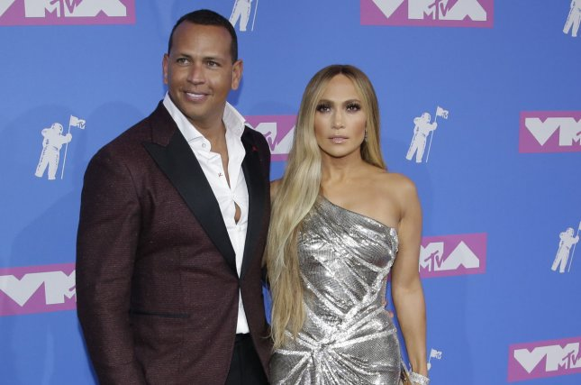 Alex Rodriguez (L), pictured with Jennifer Lopez, showed off a picture the singer autographed for him nearly 20 years ago. File Photo by Serena Xu-Ning/UPI