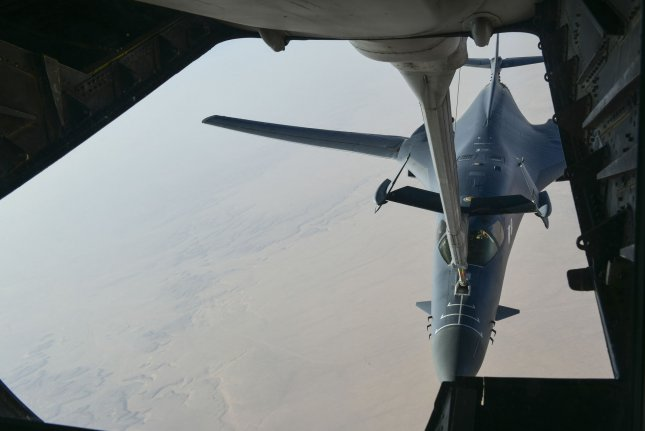 A B-1 bomber is pictured being refueled by a KC-135 Stratotanker. The 128th Refueling Wing's base was breached Sunday by a vehicle. Three suspects were arrested. File Photo courtesy of Department of Defense/UPI