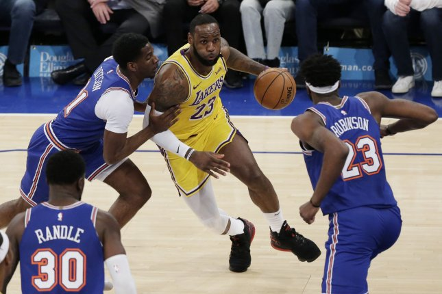 Los Angeles Lakers star LeBron James (23) drives to the basket against the New York Knicks on Wednesday night at Madison Square Garden in New York City. James led all NBA players in All-Star voting. Photo by John Angelillo/UPI
