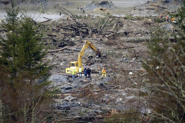 Search and rescue personnel work through the debris, searching for survivors or bodies in the aftermath of the massive mudslide in Oso, Wash., in 2014. File Pool Photo by Ted Warren/UPI
