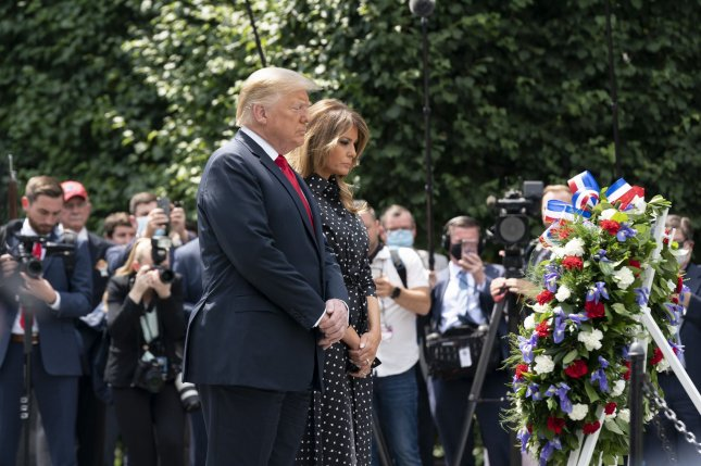 President Donald Trump and first lady Melania Trump place a wreath at the Korean War Veterans Memorial in Washington, D.C., on Thursday. Photo by Jim Lo Scalzo/UPI