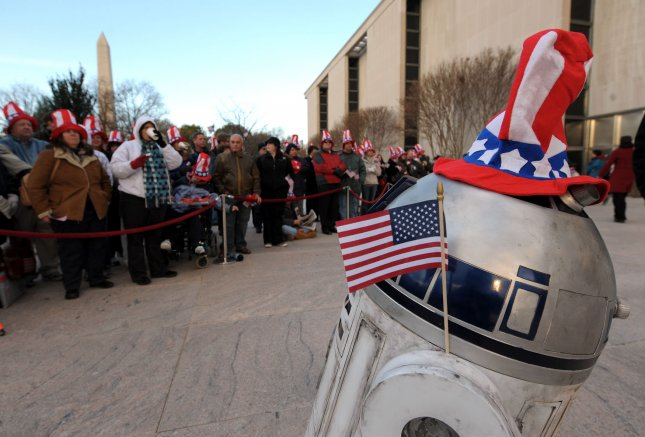 Star Wars replica robot R2D2 entertains guests during a ceremony for the reopening of the National Museum of American History in Washington on November 21, 2008. The museum, closed for renovations for two years, reopened to the public today. (UPI Photo/Roger L. Wollenberg)