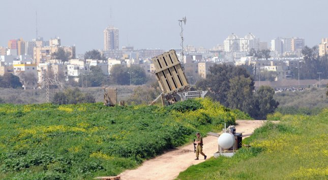 An Israeli soldier walks near the Israeli anti-missile system known as Iron Dome, used to intercept rockets fired by Palestinian militants from the Gaza Strip, in Ashdod, Israel, March 11, 2012. UPI/Debbie Hill