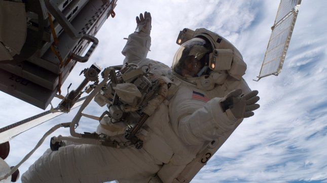 Astronaut Sunita L. Williams, Expedition 14 flight engineer, participates in the mission's third planned session of extravehicular activity (EVA) as construction resumes on the International Space Station. Astronaut Robert L. Curbeam, (out of frame), STS-116 mission specialist, also participated in the 7-hour, 31-minute spacewalk on December 16, 2006. (UPI Photo/NASA).