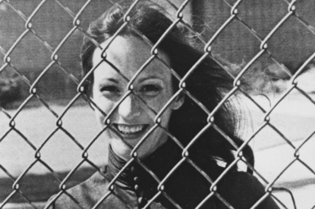 A photo taken of Miss Susan Atkins, convicted mass murderer, and once a member of the Charles Manson 'family'. She stands behind the fenced-in women's prison on August 20, 1981. She got married to self-described millionaire Donald Lee Baisure on September 2, 1981 in Frontera, CA. He turned out not be a millionaire at all and had been married 35 times already. She had the marriage annuled. Lifetime green lights film about the Manson girls. (UPI Photo/Rich Lipski/Files)