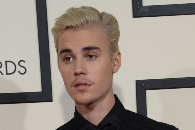 Justin Bieber arrives for the 58th annual Grammy Awards on February 15, 2016. The singer posted a note claiming he is done taking photos with fans who come across him on the street. File Photo by Jim Ruymen/UPI