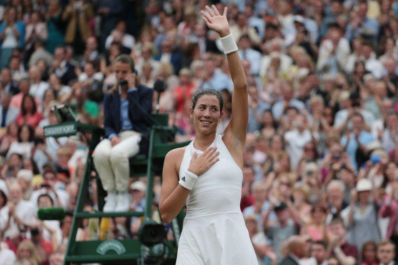 Spain's Garbine Muguruza celebrates victory in her match against American Venus Williams in the Women's Final of the 2017 Wimbledon championships, London on July 15, 2017. File photo by Hugo Philpott/UPI