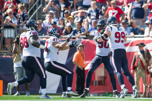 Houston Texans players celebrate after Jadeveon Clowney (90) scored on a 22-yard fumble recovery in the second quarter against the New England Patriots on September 24, 2017 at Gillette Stadium in Foxborough, Massachusetts. File photo by Matthew Healey/UPI