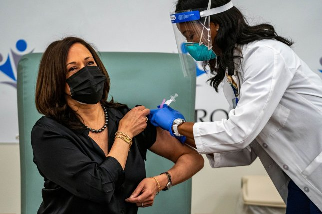 Vice President-elect Kamala Harris receives an initial dose of Moderna's COVID-19 vaccine on Tuesday at United Medical Center in Washington, D.C. Photo by Ken Cedeno/UPI