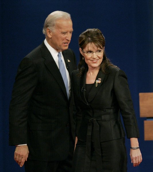 Republican vice presidential nominee, Alaska Gov. Sarah Palin (R) stands on stage with Democratic vice presidential nominee Sen. Joe Biden (D-DE) after their debate at Washington University in St. Louis, Missouri, on October 2, 2008. (UPI Photo/Brian Kersey)