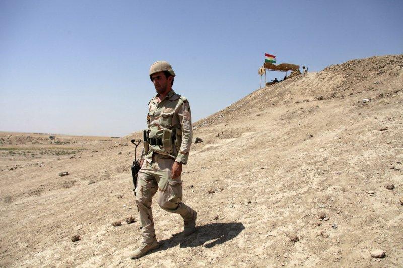 Kurdish Peshmerga soldier walks in Makhmur town, after Peshmerga took control of the town from Islamic State militants, northwest of Erbil, Kurdistan region, Iraq, August 28, 2014. UPI/Mohammed al Jumaily