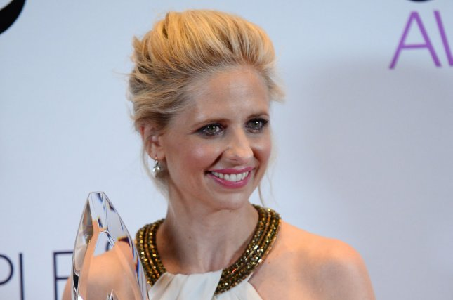 Actress Sarah Michelle Gellar appears backstage with the Favorite Actress in a New TV Series award she garnered at the People's Choice Awards in 2014. File Photo by Jim Ruymen/UPI