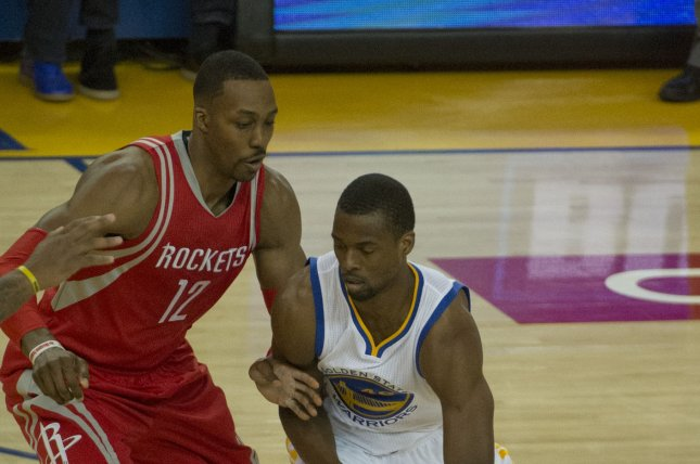 Golden State Warriors' Harrison Barnes drives against Houston Rockets' Dwight Howard (12) in the second period of game 5 of the NBA playoffs at Oracle Arena in Oakland, California on April 27, 2016. The Warriors defeated the Rockets 114-81 to win the first round of playoff 4-1. Photo by Terry Schmitt/UPI
