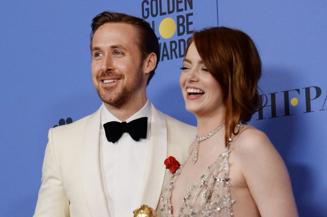 Ryan Gosling and Emma Stone, winners of the awards for Best Performance by an Actor and Actress in a Motion Picture Musical or Comedy respectively for La La Land, appear backstage with their trophies during the 74th annual Golden Globe Awards in Beverly Hills on January 8. The movie was nominated for 14 Oscars on Tuesday. Photo by Jim Ruymen/UPI