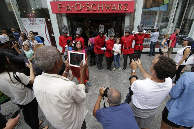 Customers gather outside at FAO Schwarz on its last day of business on Fifth Avenue in New York City in 2015. The store reopened in New York City Friday. Photo by John Angelillo/UPI