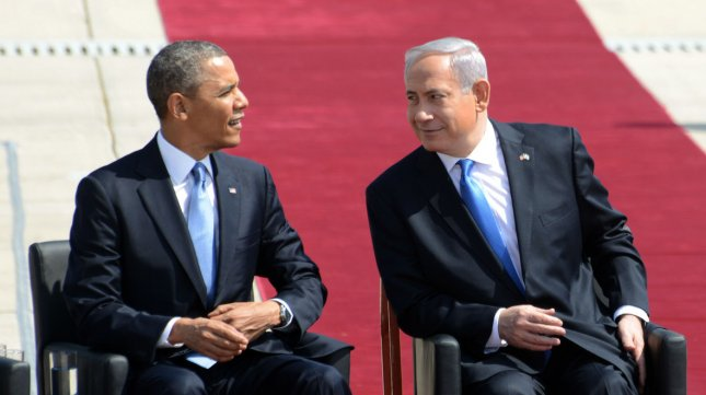 (R) Israeli Prime Minister Benjamin Netanyahu looks at (L) US President Barack Obama during a welcoming ceremony at Ben Gurion Airport near Tel Aviv, Israel, March 20, 2013. Obama will spend three days in the Holy Land on his first visit as President of the United States of America. UPI/Debbie Hill