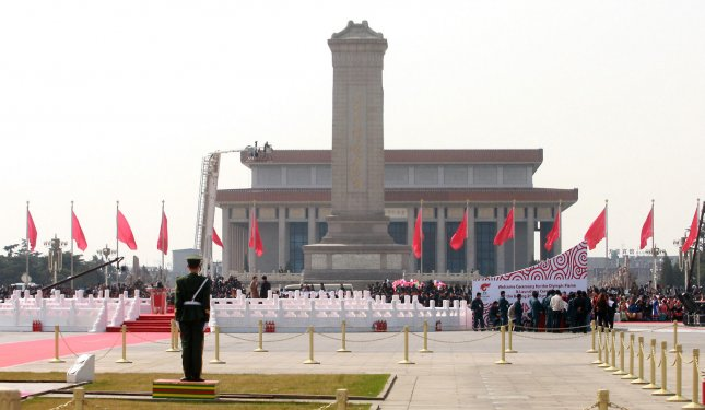Top government officials and guests assemble on Tiananmen Square for the Olympic torch's arrival and lighting ceremony in Beijing on March 31, 2008. (UPI Photo/Stephen Shaver)