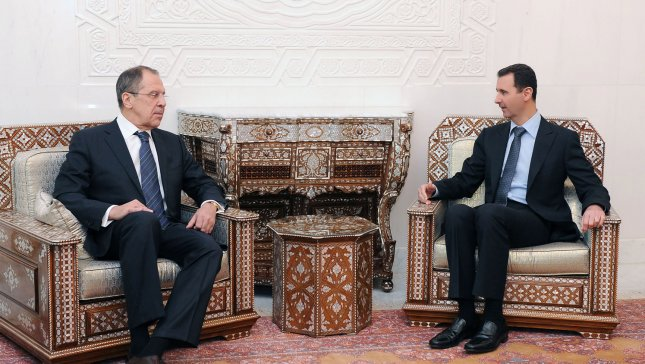 Syria's President Bashar al-Assad (R) speaks with visiting Russia's Foreign Minister Sergei Lavrov during their meeting at the presidential palace in Damascus, on February 7, 2012, in this official handout photo. UPI