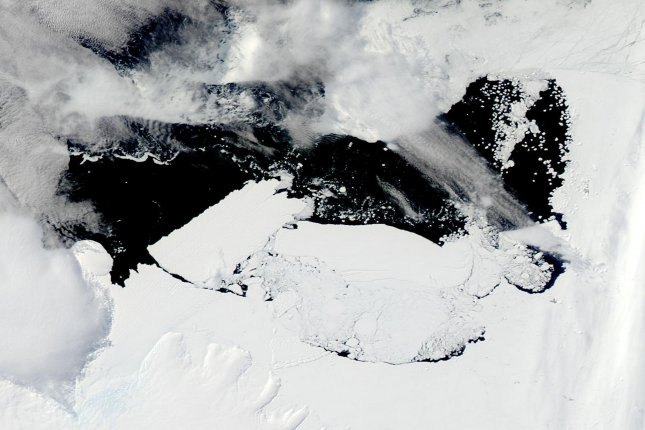 This February 20, 2010 image from NASA's Aqua satellite shows an oblong iceberg, roughly the size of Rhode Island, called B-09B (center-right) colliding with the edge of the Mertz Glacier in eastern Antarctica this month, breaking away a new iceberg (top-left) that is nearly as large at B-09B. UPI/NASA