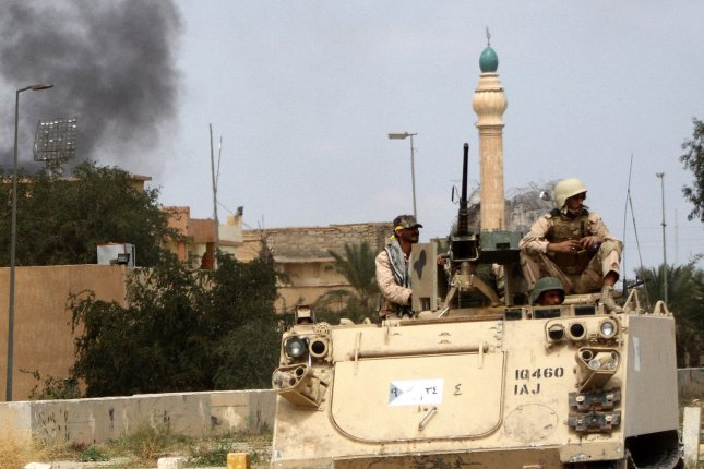Iraqi soldiers ride atop an armored vehicle during fighting with Islamic State militants in Tikrit, Iraq, on April 1, 2015. On Oct. 13, 2015, Iraqi forces began advancing on IS-held territories in Saladin province, of which Tikrit is the capital. The day before, Iraqi Prime Minister Haider al-Abaidi announced a second phase in the liberation of the province. Photo by Alaa Mohamed/UPI