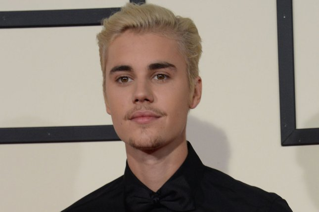 Justin Bieber arrives for the 58th annual Grammy Awards in Los Angeles on February 15, 2016. The recording artist is to appear on Tuesday night's telethon to aid victims of Hurricanes Harvey and Irma. File Photo by Jim Ruymen/UPI