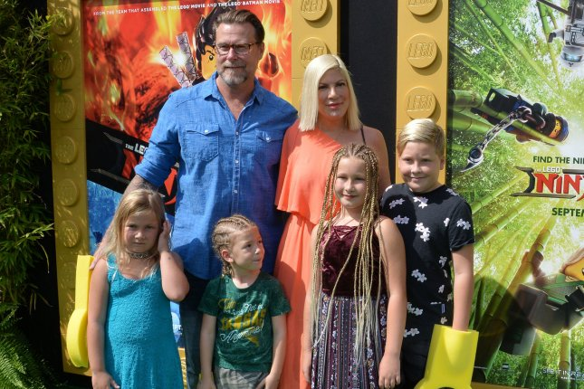 Tori Spelling and Dean McDermott, pictured with four of their kids, attended the 2017 Mattel Party on the Pier fundraiser Sunday. File Photo by Jim Ruymen/UPI