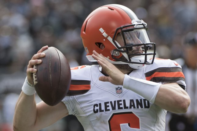Cleveland Browns rookie quarterback Baker Mayfield fakes a pass during a game against the Oakland Raiders on September 30, 2018. Photo by Terry Schmitt/UPI