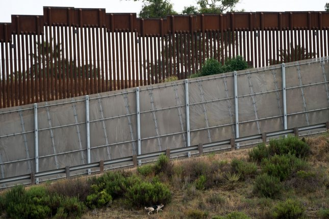 Two Congressional Democrats have asked the Pentagon's acting inspector general to investigate a border wall contract awarded to a Montana contractor this month. In this June 2019 photo, a dog roams the U.S. - Mexico border fence at International Friendship Park in Imperial Beach, Calif. Photo by Kevin Dietsch/UPI