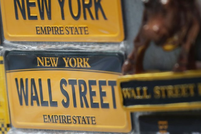 The Dow Jones Industrial Average fell 222 points on Tuesday as the United States reported another 66,800 COVID-19 cases and Caterpillar stock dropped after reporting decreased earnings. Photo by John Angelillo/UPI