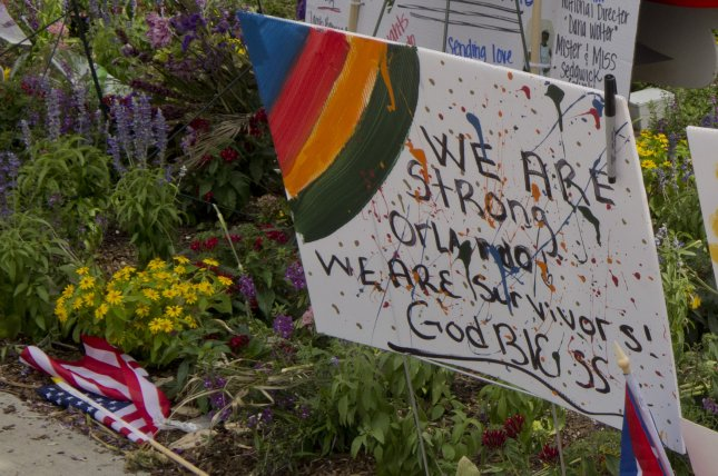 A sign at the memorial in remembrance of the victims of the Pulse nightclub massacre in Orlando, Fla., June 16, 2016. File Photo by Gary I Rothstein/UPI