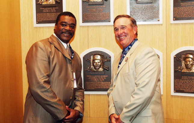 National Baseball Hall of Fame members Gary Carter (R) and Eddie Murray pose for a photograph in front of their placques in the grand hall at the National Baseball Hall of Fame and Museum in Cooperstown, New York on July 25, 2009. The two were inducted into the hall in 2003. Carter died Thursday at age 57. (UPI Photo/Bill Greenblatt)