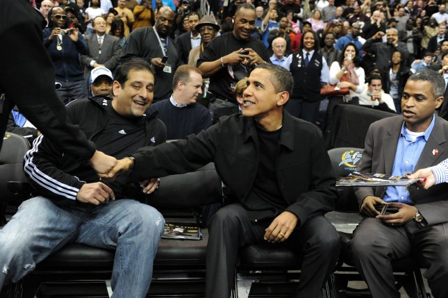 U.S. President Barack Obama (C) is greeted by fans and friends at a NBA (National Basketball Association) game between the Washington Wizards and Chicago Bulls, at the Verizon Center in Washington on February 27, 2009. (UPI Photo/Michael Reynolds/Pool)