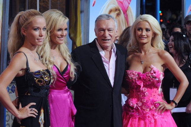 Kendra Wilkinson, Bridget Marquardt, Hugh Hefner and Holly Madison (L-R) at the Los Angeles premiere of 'The House Bunny' on Aug. 20, 2008. Madison claimed Hefner tried to bribe her to stay on Saturday's episode of 'Oprah: Where Are They Now.' File Photo by Jim Ruymen/UPI