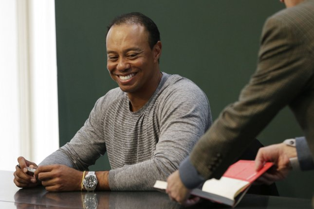 Tiger Woods signs a copy of his book, The 1997 Masters: My Story, at the Union Square Barnes & Noble in New York City on March 20, 2017. The book is a reflection on his historic Masters win in honor of its upcoming twentieth anniversary. Photo by John Angelillo/UPI