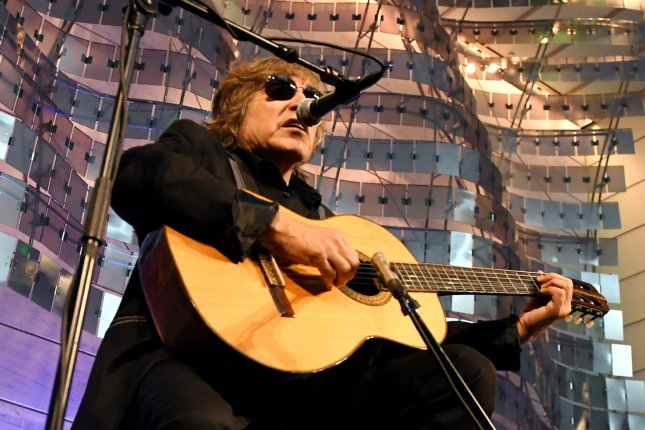 Grammy Award-winning musician Jose Feliciano sings the national anthem during a naturalization ceremony for 20 new Americans from 17 countries in the Flag Hall of the Smithsonian's National Museum of American History in Washington, D.C., on Thursday. Photo by Pat Benic/UPI