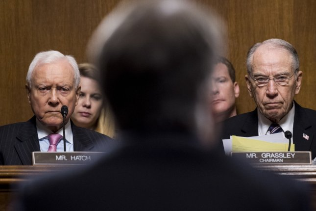 Sen. Orrin Hatch, R-Utah, left, and Sen. Chuck Grassley, R-Iowa, listen as Judge Brett Kavanaugh testifies during the Senate judiciary committee hearing on his nomination be an associate justice of the Supreme Court of the United States. Photo By Tom Williams/UPI