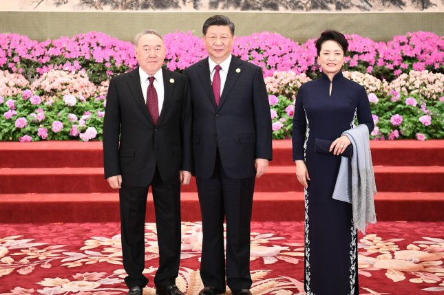 Chinese President Xi Jinping (C) and his wife, Peng Liyuan, pose for a photo with Kazakhstan President Nursultan Nazarbayev before a banquet during the Second Belt and Road Forum in Beijing in April. File Pool Photo by Xie Huanchi/UPI