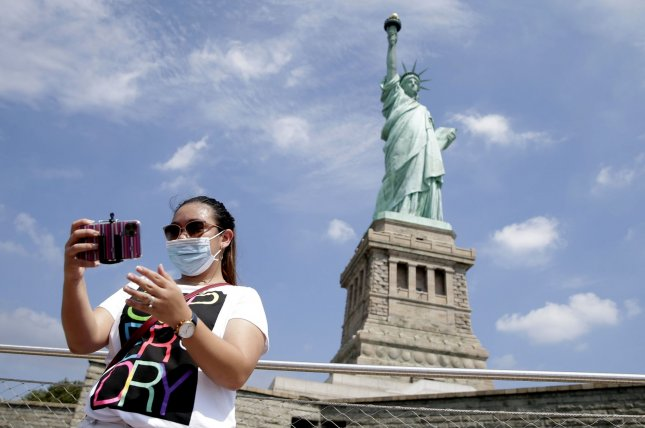 The Statue of Liberty reopened Monday with reduced capacity to help maintain social distancing due to the coronavirus. Photo by John Angelillo/UPI