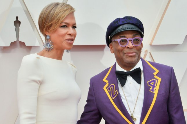 Spike Lee (R) and his wife Tonya Lewis Lee arrive for the 92nd annual Academy Awards on February 9. Spike Lee will receive the American Cinematheque Award. File Photo by Jim Ruymen/UPI