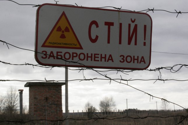 A sign declaring Halt! Prohibited Zone is seen in the exclusion zone around the closed Chernobyl nuclear power plant in the Ilinci village, April 5, 2006. File Photo by Sergey Starostenko/UPI