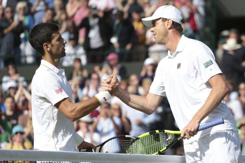 A victorious American Sam Querrey shakes Serbian Novak Djokovic's hand on Day six of the 2016 Wimbledon Championships in Wimbledon, London July 02, 2016. Photo by Hugo Philpott/UPI