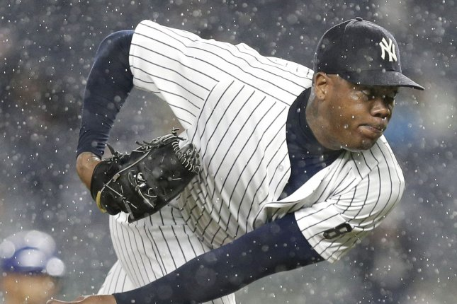 New York Yankees Aroldis Chapman throws a pitch in the rain in the 9th inning against the Texas Rangers at Yankee Stadium in New York City on June 27, 2016. Photo by John Angelillo/UPI