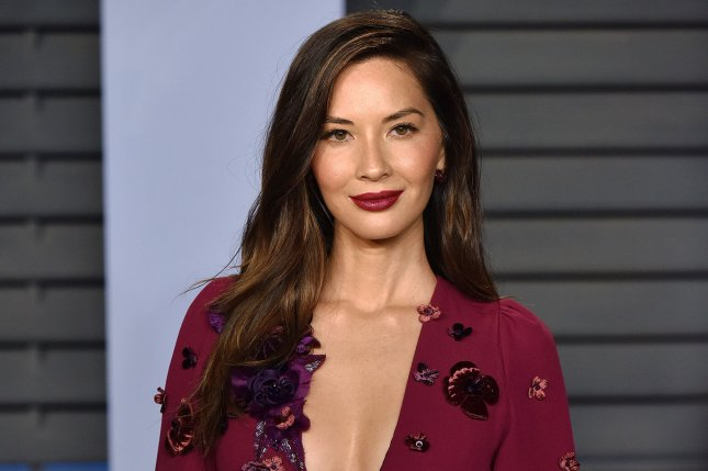 Olivia Munn debuted her new, wavy locks in a series of Instagram clips Monday. File Photo by Christine Chew/UPI