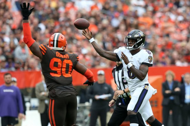 Baltimore Ravens quarterback Lamar Jackson throws a pass with pressure from Cleveland Browns' Emmanuel Ogbah in the first half on October 7 at First Energy Stadium in Cleveland. Photo by Aaron Josefczyk/UPI